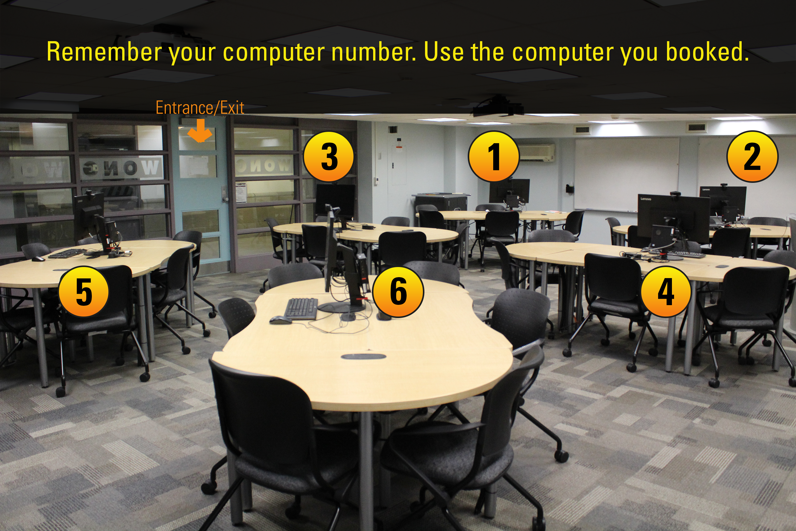 Media computers set up in the Wong e-Classroom that are numbered.
