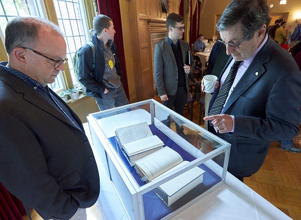 Bernard Linsky (right) looks at the corrected proofs of volumes I and II of Principia Mathematica which were on display during a recent event hosted by the Library. The event, held at the University Club, brought together members of McMaster's Departments