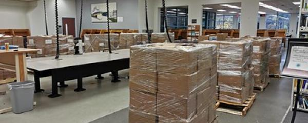 Boxes of books on pallets at Innis Library