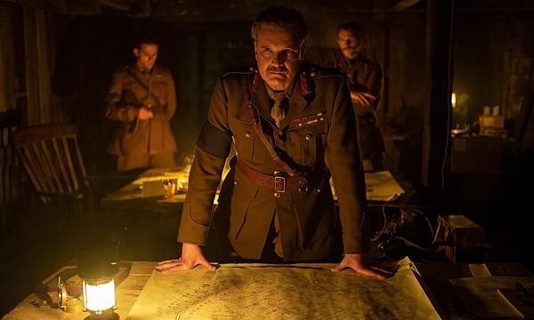 Colin Firth, as General Erinmore in the film 1917, stands over a map from McMaster's extensive World War One trench map collection.