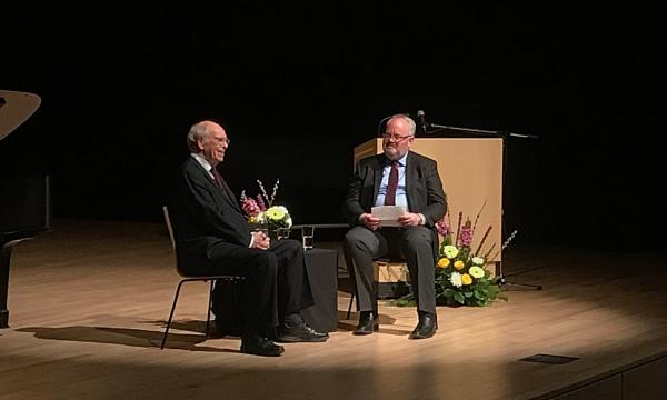 "Wade Hemsworth, media relations manager and author, is interviewed by professor emeritus Alan Walker on his critically acclaimed new biography ""Fryderyk Chopin: A Life and Times"" at a special literary concert held recently in L.R. Wilson Hall."